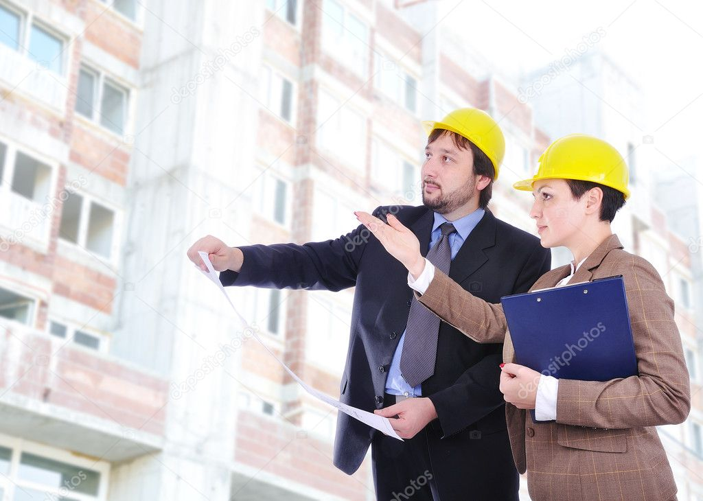 Two young engineers with blueprints — Stock Photo #9993088