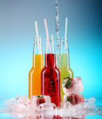 Colorful cocktails over blue background — Stock Photo