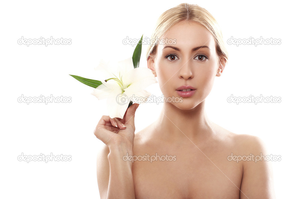Beautiful blonde with lily flower over white background  Stock Photo #10282638