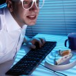 Nerd surfing internet at night time — Stock Photo