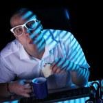 Nerd surfing internet at night time — Stock Photo #8446365