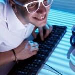 Nerd surfing internet at night time — Stock Photo