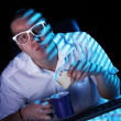 Nerd surfing internet at night time — Stockfoto