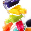 Bottles with spilled nail polish — Stock Photo #8446670