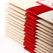 Gift envelopes with red bow — Stock Photo #8447344