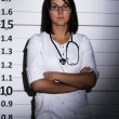 Doctor over  jail background - Stok fotoğraf