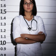 Doctor over  jail background - Stockfoto
