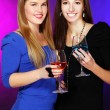 Two cheerful girlfriends with colorful cocktails — Stock Photo #8447815