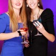 Two cheerful girlfriends with colorful cocktails — Stock Photo #8447819