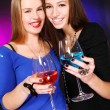 Two cheerful girlfriends with colorful cocktails — Stock Photo #8447826