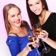 Two cheerful girlfriends with colorful cocktails — Stock Photo #8447827