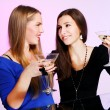 Two cheerful girlfriends with colorful cocktails — Stock Photo #8447836
