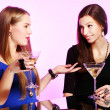 Two cheerful girlfriends with colorful cocktails — Stock Photo #8447839