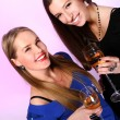Two cheerful girlfriends with colorful cocktails — Stock Photo