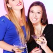 Two cheerful girlfriends with colorful cocktails — Stock Photo #8447846