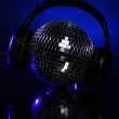 Discoball with headphones on top — Stock fotografie