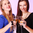 Two cheerful girlfriends with colorful cocktails — Stock Photo #8447854