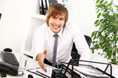Young businessman welcomes you — Stock Photo