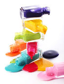 Bottles with spilled nail polish — Stock Photo