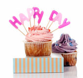 Birthday cupcakes with colorul latters — Stock Photo
