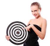 Woman with dart target — Stock Photo