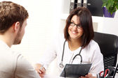 Woman doctor talking with patient — Foto Stock