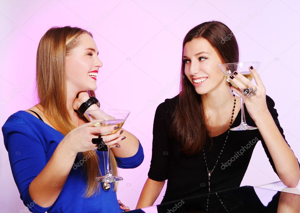 Two young and cheerful girlfriends with colorful cocktails — Stock Photo #8447829