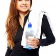 Young woman with bottle in hands — Stock Photo