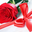 Red rose and holiday envelope - Stock Photo