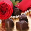 Red rose and chocolate candies — Stock Photo #8801267