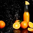 Fresh orange drink with splashes of water — Stock Photo