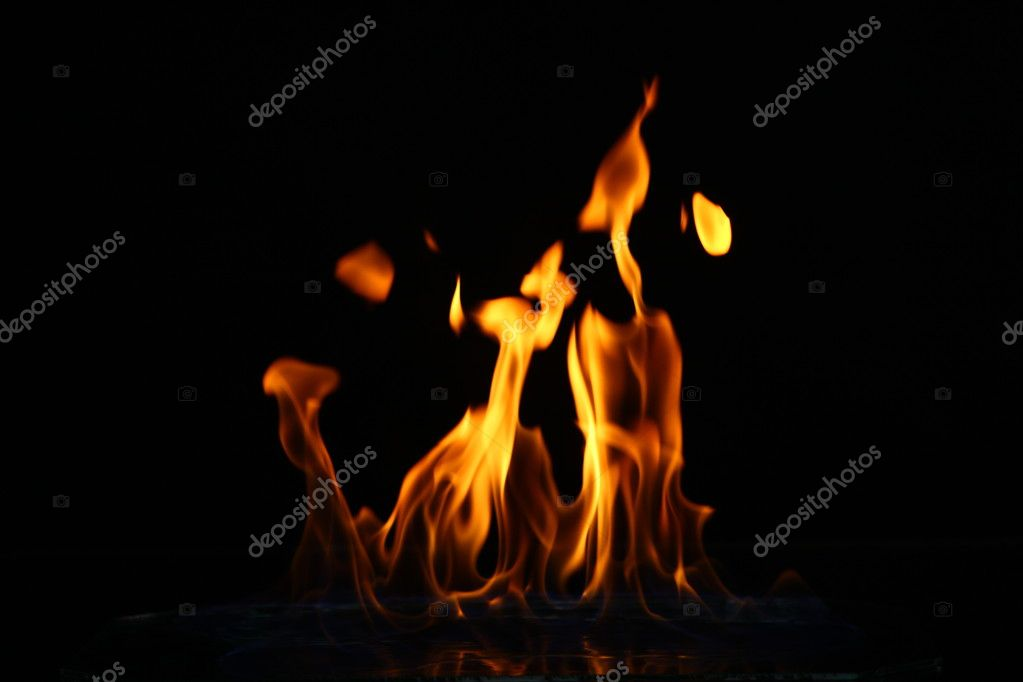 Glowing fire flame over black background  Stock Photo #8800542