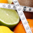 Fresh fruits and measure tape - Stockfoto