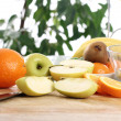 Fresh fruits on the kitchen table — Stock Photo
