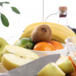 Fresh fruits on the kitchen table — Stock Photo #9225377