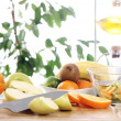 Fresh fruits on the kitchen table — Stock Photo #9225400