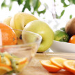 Fresh fruits on the kitchen table — Stock Photo #9225451
