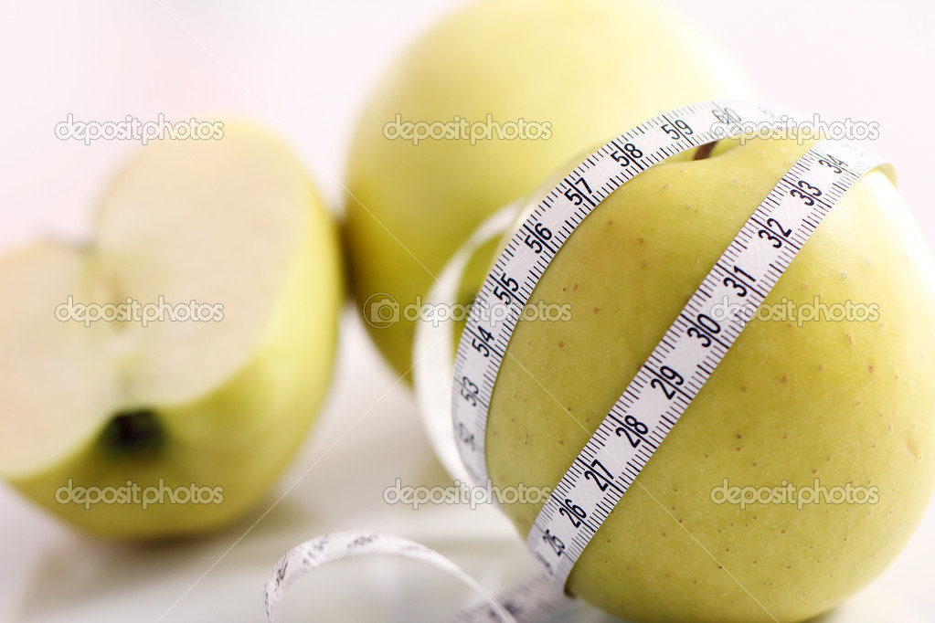 Close up of Green apples with measure tape — Stock Photo #9224869