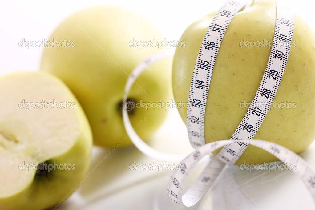 Close up of Green apples with measure tape  Stock Photo #9224887