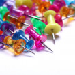 Colorful pins over white background - Stock Photo