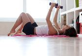 Young woman doing gymnastic exercises — Stock Photo