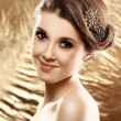 Stock Photo: Beautiful woman with brooch in hair