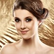 Beautiful woman with brooch in hair — Stock Photo