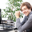 Young smiling man in office — Stock Photo