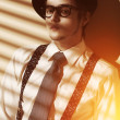 Stylish guy in sunset light — Stok fotoğraf