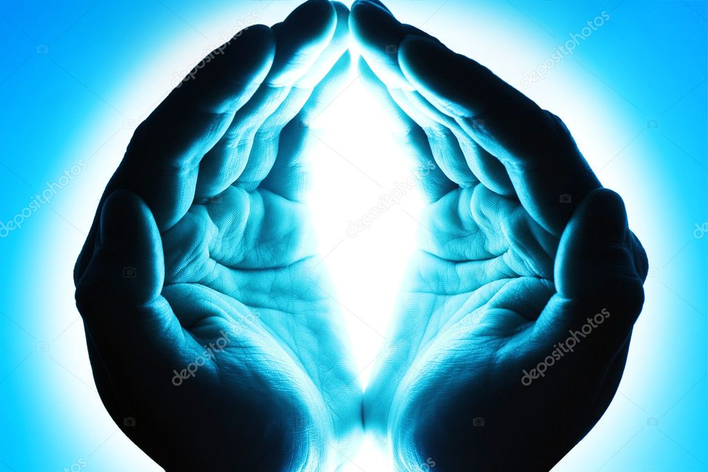 Human hands in blue light — Stock Photo #9704090