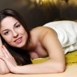 Young woman relaxing in spa salon — Stock Photo #9795432
