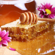 Honey on the wooden table - Foto Stock