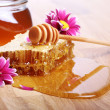 Honey on the wooden table — Stok fotoğraf