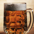 Glass of beer over wooden surface — Stock Photo